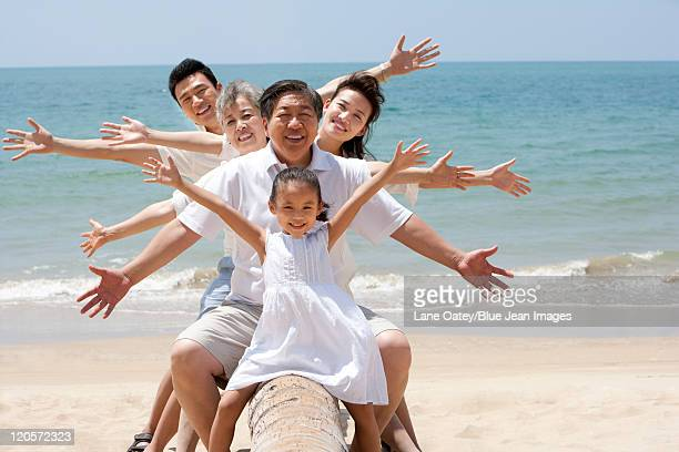 Happy Family Posing at the Beach