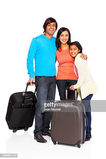 Happy family prepared to go traveling