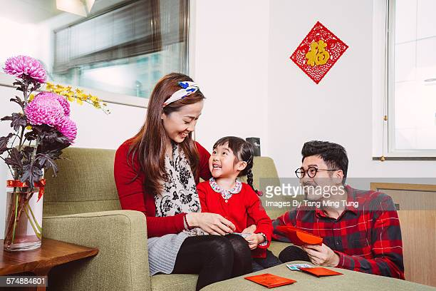 Happy family preparing Chinese New Year joyfully