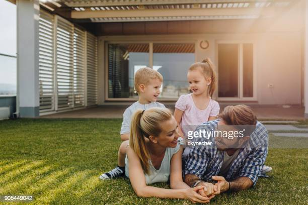 happy family relaxing on a penthouse terrace and communicating. - penthouse girl stock photos and pictures