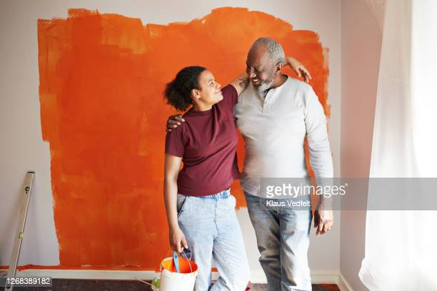 happy family renovating home together= - daughter stock pictures, royalty-free photos & images