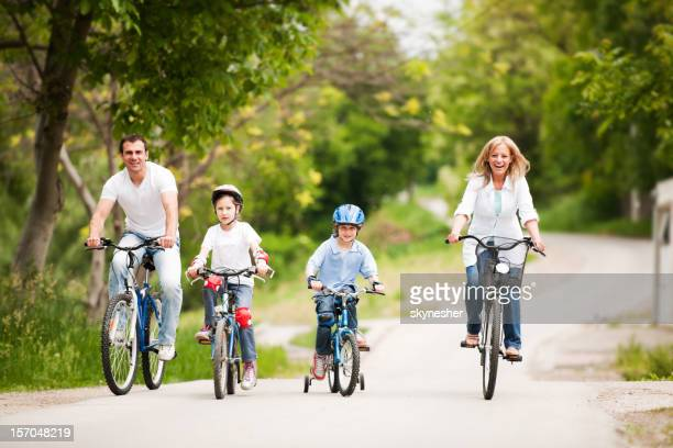 Happy family riding bicycle.