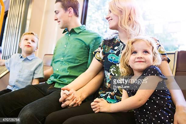 Happy Family Riding Metro Train
