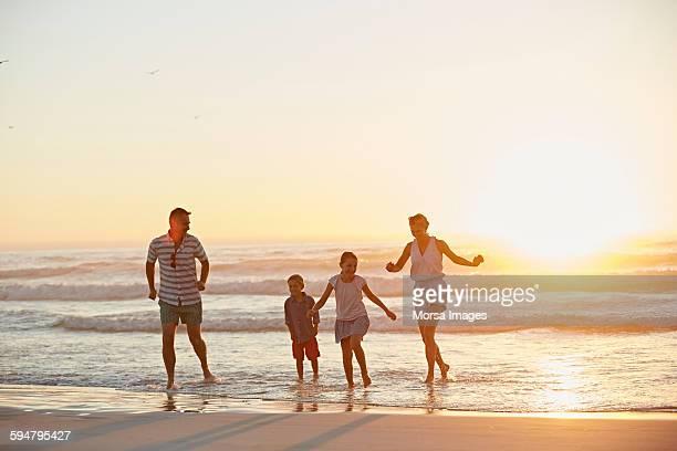 Happy family running on shore
