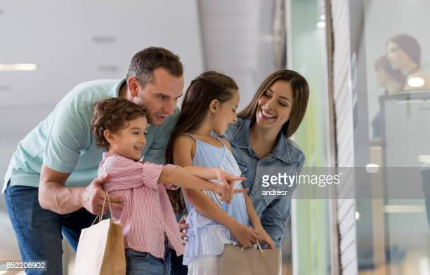 Happy family shopping at the mall