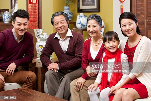 Happy family sitting in sofa during Chinese New Year