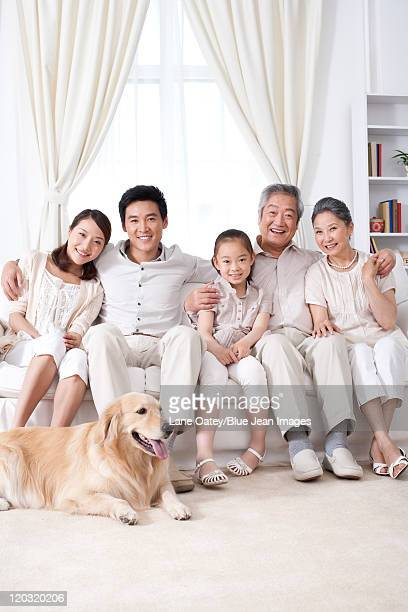 Happy Family Sitting on a Sofa