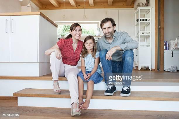 Happy family sitting on kitchen steps