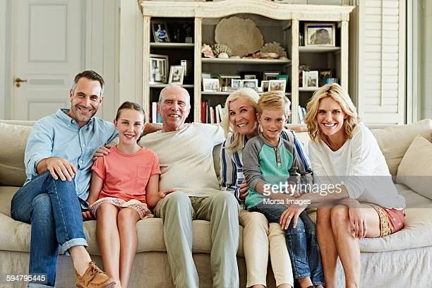 happy family sitting on sofa - famiglia con due figli foto e immagini stock