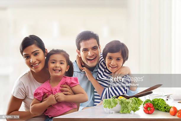 Happy family sitting together at kitchen table