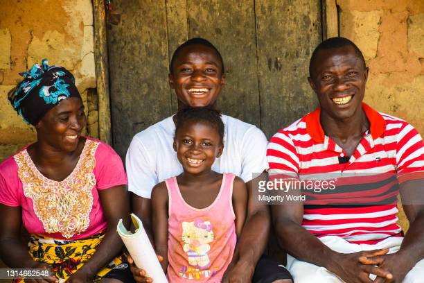 Happy family smile for a photograph in Sierra Leone.