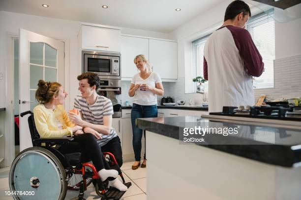 happy family socialising in the kitchen - epilepsy stock pictures, royalty-free photos & images