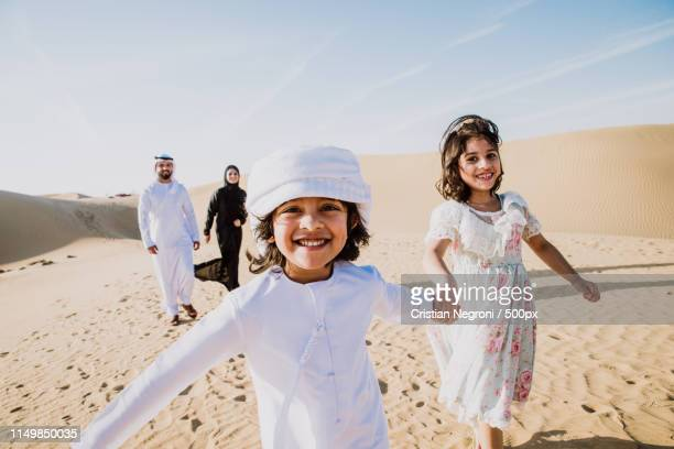 happy family spending a wonderful day in the desert making a pic - gulf countries stock-fotos und bilder