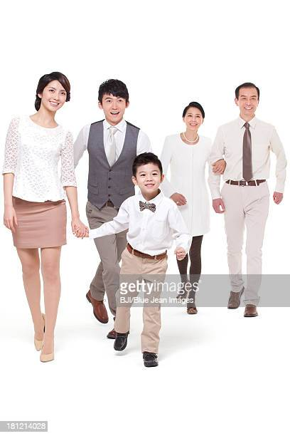 Happy family stepping forward