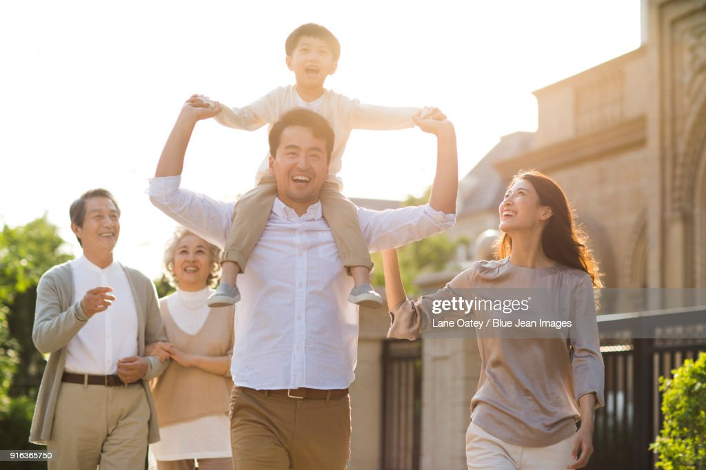 Happy family strolling outside : Stock Photo