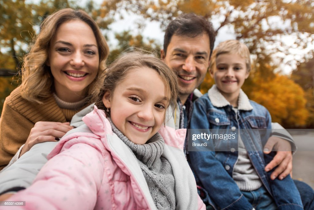 Happy family taking a self portrait photography in nature. : Stock Photo