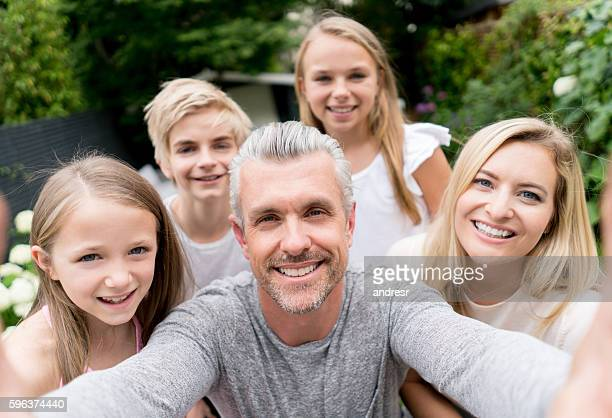 happy family taking a selfie - five people stock pictures, royalty-free photos & images