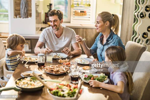 happy family talking during lunch time in dining room. - pranzo foto e immagini stock