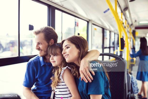 happy family traveling together in bus - izusek stock pictures, royalty-free photos & images