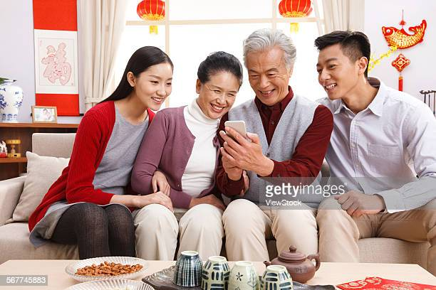 Happy family use mobile phone