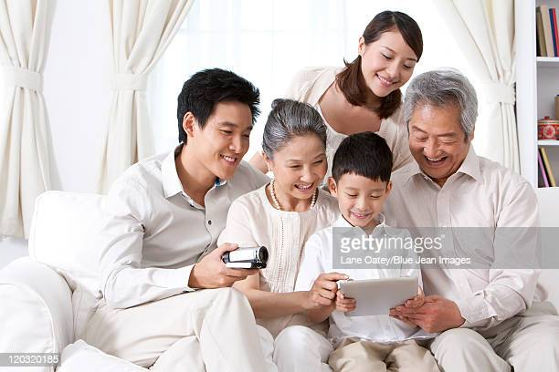 Happy Family Using an iPad together