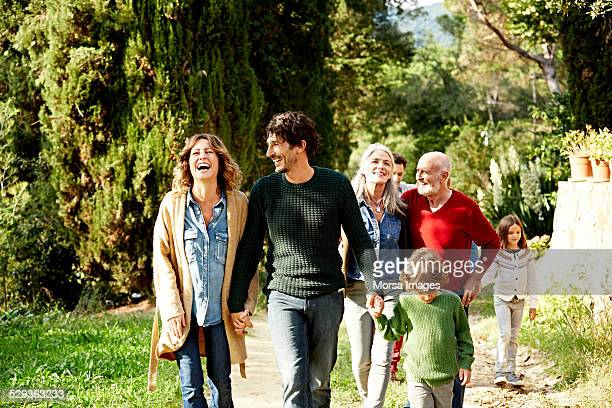 happy family walking in park - multi generation family stock pictures, royalty-free photos & images