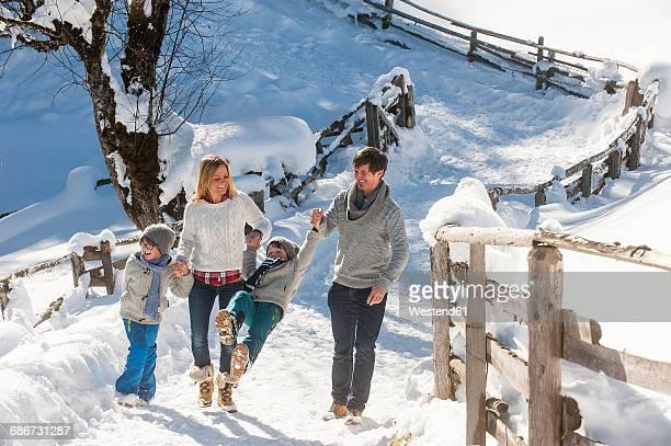 Happy family walking in snow