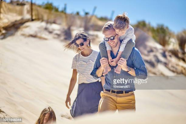 happy family walking on the beach together - australia photos stock photos and pictures