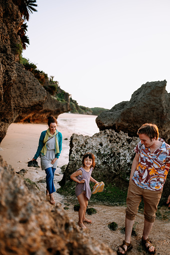 Happy family walking on tropical beach at sunset, Ishigaki Island, Japan - gettyimageskorea