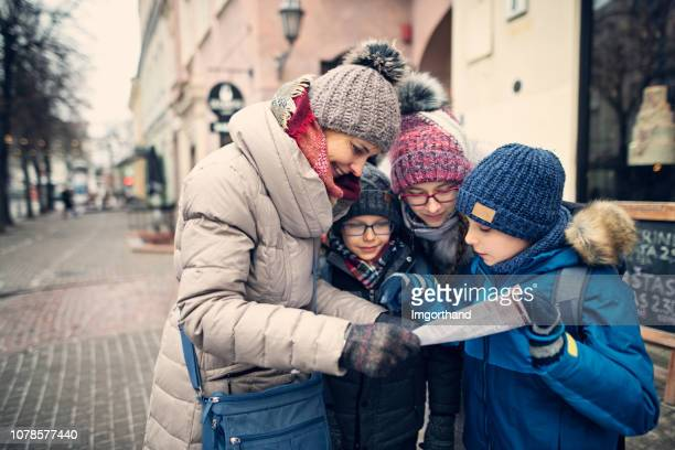 happy family walking streets of old town in vilnius, lithuania - lithuania stock pictures, royalty-free photos & images