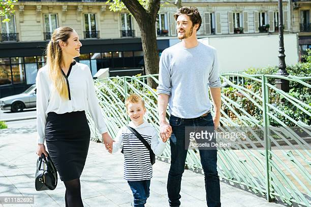 Happy Family Walking Through The Park Taking Son to School