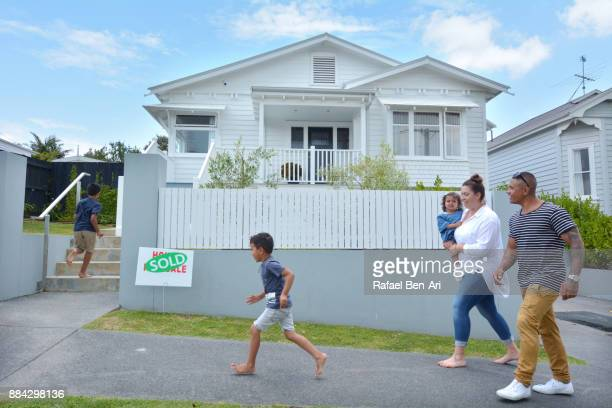 Happy family walking towards their new home