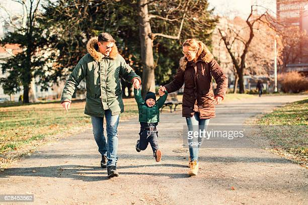 Happy Family Walks In The Park