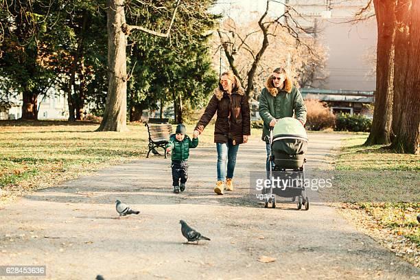 Happy Family Walks In The Park