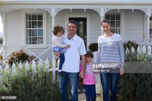 happy family walks out of their new home - rafael ben ari fotografías e imágenes de stock