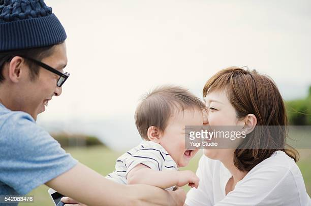 Happy family with baby boy.
