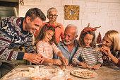 joyful multigeneration family baking christmas cookies