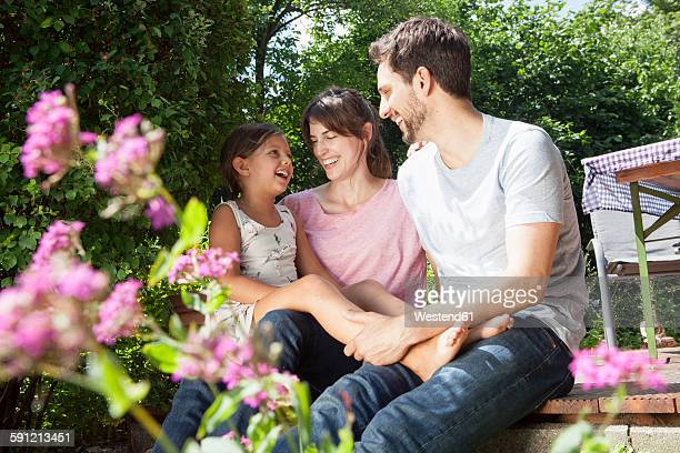Happy family with daughter in garden