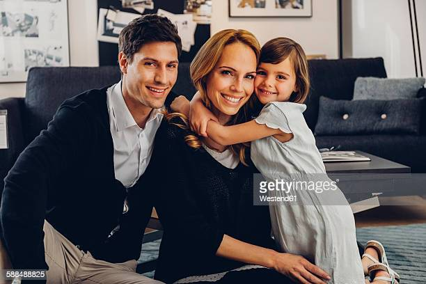 Happy family with daughter in living room