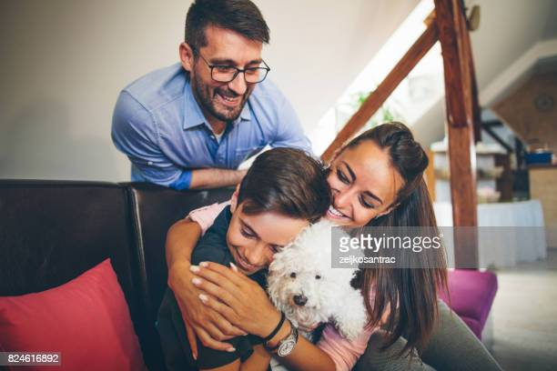 Happy Family With Dog at Home