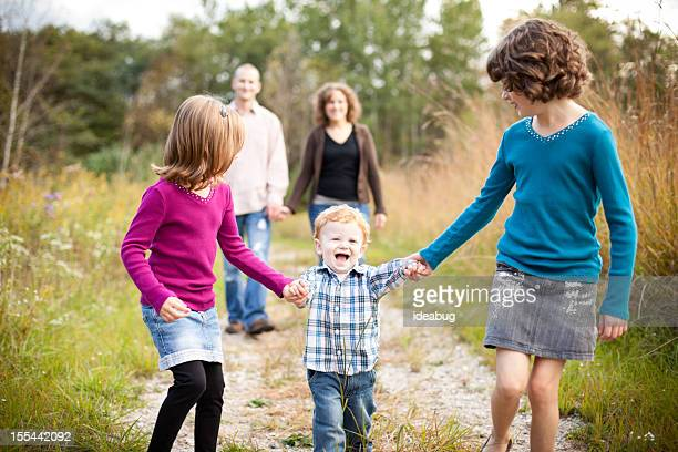 happy family with father, mother, daughters, and son - lane sisters stock photos and pictures
