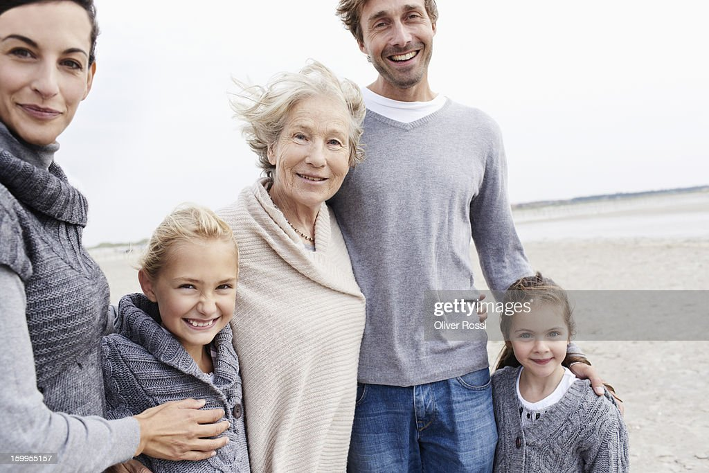 Happy family with grandmother on the beach : Stock Photo