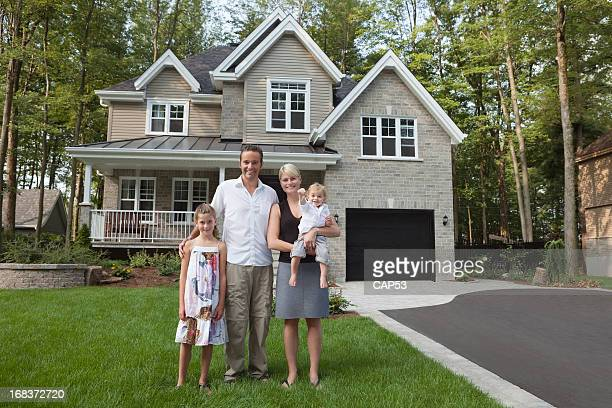 Happy Family With Key Of Their New House