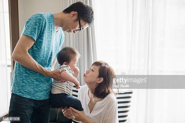 Happy family with newborn baby.