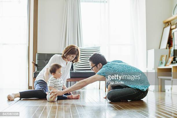happy family with newborn baby. - asian baby stockfoto's en -beelden