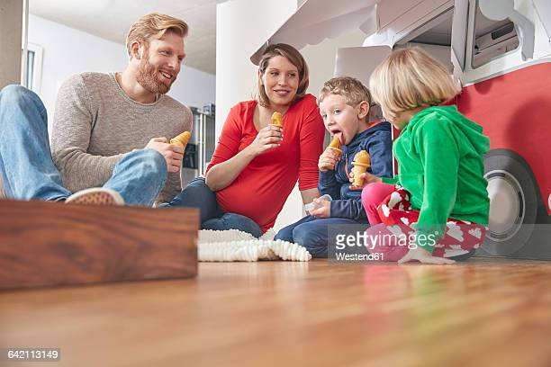 happy family with popsicles and model car in living room - lolly models stock pictures, royalty-free photos & images