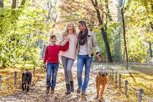 happy family with their dogs in a park