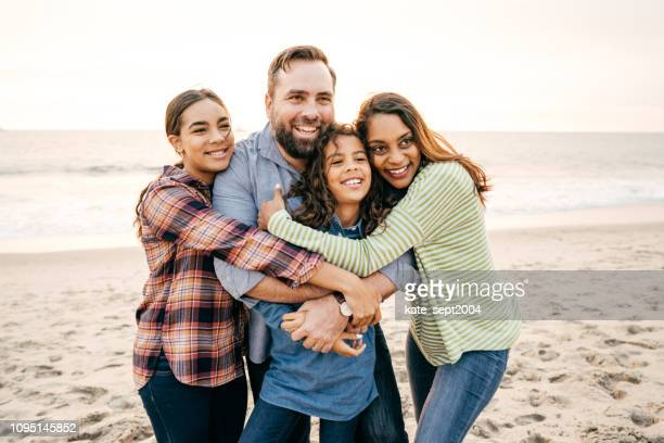 happy family with two teen kids - mixed race person stock pictures, royalty-free photos & images