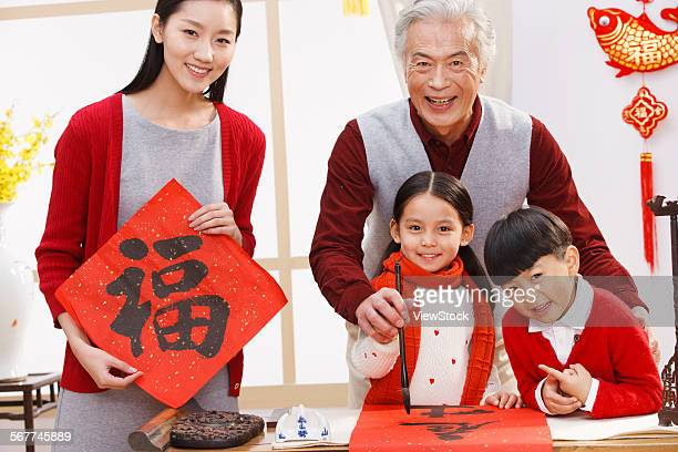 Happy family write Spring Festival couplets to prepare for the holiday