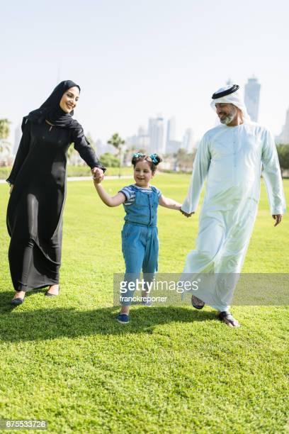 happy familywalking in the park